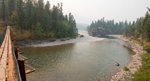 Suspension Bridge over Flathead River at the Spotted Bear Ranger Station / Campground in Montana USA Stock Photography