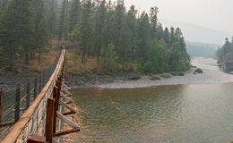 Suspension Bridge over Flathead River at the Spotted Bear Ranger Station / Campground in Montana USA Royalty Free Stock Image