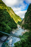 Suspension bridge over a gorge Royalty Free Stock Image