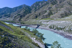 Suspension bridge. Over the Katun river in Inya village at Altai region in Siberia Royalty Free Stock Image