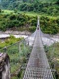 Suspension bridge over Marsyangdi river, Nepal Royalty Free Stock Image
