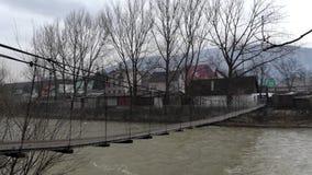 Suspension bridge over the mountain bridge. stock footage