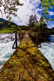 Suspension bridge over the mountain river, Norway. royalty free stock photography