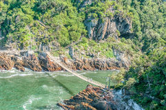 Suspension bridge over the Mouth of the Storms River Royalty Free Stock Image