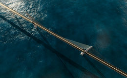 Suspension bridge over ocean Stock Photos