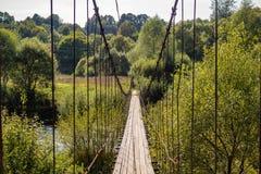 Suspension bridge over the Protva river, Russia. Suspension bridge over the Protva river in the village of Satino, Borovsky district, Kaluzhskiy region, Russia stock photos