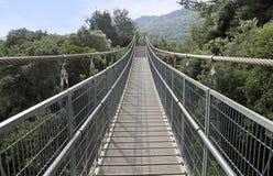 Suspension bridge over the ravine. Modern suspension bridge over the ravine Royalty Free Stock Photography