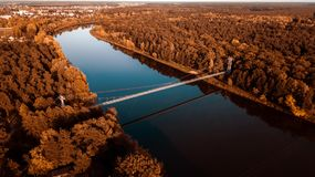 Suspension bridge over the river. aerial photography from a drone stock photos