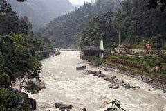 Suspension bridge over a river Stock Images