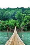 Suspension Bridge over the River highlands. Royalty Free Stock Images
