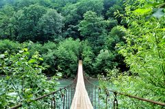 Suspension Bridge over the River highlands. Stock Photo