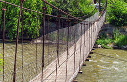 Suspension bridge over river Royalty Free Stock Photo