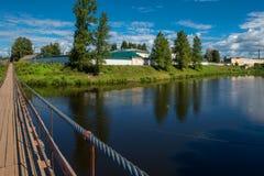 View from the suspension bridge. Suspension bridge over the river Msta on a summer day. City Borovichi, Russia stock image