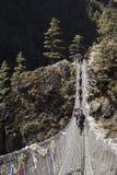 Suspension bridge over a river in Nepal. Stock Photo