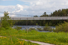 Suspension bridge over the river Royalty Free Stock Images