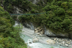 Suspension bridge over river at the Taroko National Park in Taiwan Stock Images
