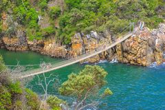 Storms River Suspension Bridge. The Suspension Bridge over the Storms River Mouth within Tsitsikamma National Park, Eastern Cape, near Plettenberg Bay in South Royalty Free Stock Image