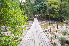 Suspension bridge over the stream Royalty Free Stock Photography