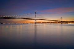 Suspension bridge over Tagus river at nightfall Stock Photography