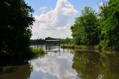 Suspension Bridge over Water at Horton Slough. View of suspension bridge over waterway at Horton Slough Park in Oklahoma Royalty Free Stock Photo