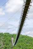 Suspension bridge for pedestrians in Hunsrück in Germany. The Suspension bridge Geierlay is for pedestrians. The bridge is in Hunsrück, a low mountain range in Stock Photos
