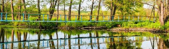 Suspension bridge through a reservoir Royalty Free Stock Photos