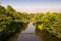 Suspension bridge through the river. Old suspension bridge through the river Istra, Moscow suburbs stock photos