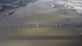 Suspension Bridge and River Aerial View stock footage