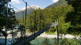 Suspension bridge from rope and wood in Mount Aspiring National Park, New Zealand. Suspension bridge from rope and wood in Mount Aspiring National Park royalty free stock photography