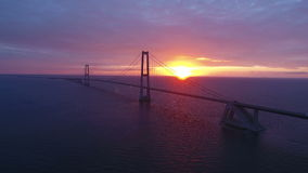 Suspension bridge on sea in Denmark at sunset stock video footage