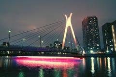 Suspension bridge and ship Stock Photo