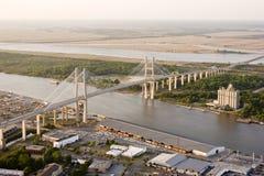 Suspension bridge and shipyard royalty free stock image