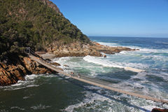 Suspension bridge in South Africa. Suspension bridge over the Storms River in Tsitsikamma National Park, South Africa stock image