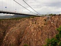 Suspension bridge. Stormy sky. Royalty Free Stock Photos