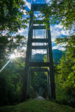 Suspension bridge in the sun Royalty Free Stock Photography
