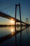 Suspension bridge in sunrise. Suspension, bridge, sun, sunrise, sunset, water, sky, blue, light, siberia, krasnoyarsk, Yenisei, river, light, summer Royalty Free Stock Images