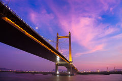 Suspension bridge at sunset Stock Photography