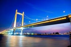 Suspension bridge at sunset Stock Photos