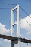 Suspension bridge support against blue sky Stock Photo