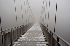 Suspension bridge. In thick fog Royalty Free Stock Photography