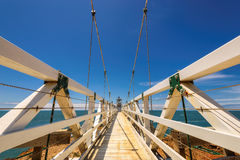 Suspension bridge to Lighthouse under beautiful sky, Point Bonita Lighthouse. California stock photography