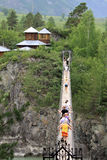 Suspension bridge to the monastery on the island of Patmos, Altai, Russia Stock Photography
