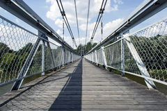 Suspension bridge. Under wide river Stock Photo