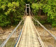 Suspension bridge using bamboo and iron royalty free stock photo