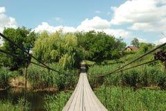 Suspension bridge. View at suspension wooden bridge Stock Photography