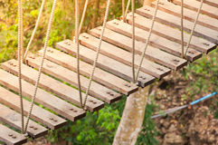 Suspension bridge, walkway to the adventurous. Cross to the other side forest Royalty Free Stock Photos