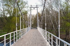 Suspension bridge. With wooden flooring Royalty Free Stock Photos