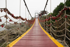 Suspension bridge in Yantai China. A heart shaped lockets chained to a bridge near Yantai China in Shandong province Stock Photos