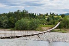 Suspension cable bridge, Crossing the river. Adygea republic, Krasnodar region, Russia Royalty Free Stock Photo