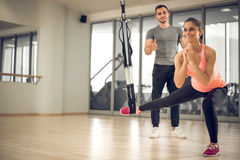 Suspension exercise with personal trainer. Royalty Free Stock Image